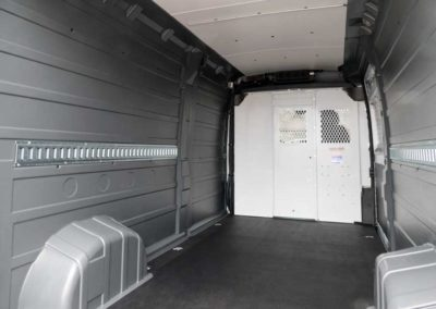 Side view showing rail. RAM ProMaster with custom installed wall liner and headliner by Cicioni.