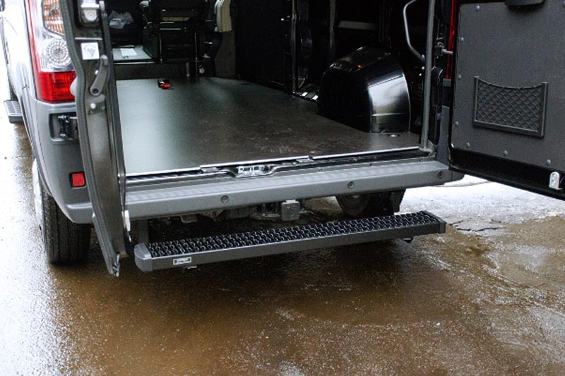Rear steps for easy entry to the cargo area of a Sprinter or other commercial cargo vehicle.