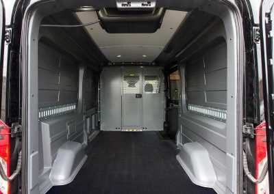 Rear view, completed - 2016 Ford Transit Cargo Van 148 in. WB, Medium Roof, 3.5L - Rooftop condenser, wall liner, independent high capacity rear headliner, partition and wing kit installation