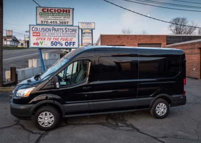 Exterior - 2016 Ford Transit Cargo Van 148 in. WB, Medium Roof, 3.5L - Rooftop condenser, wall liner, independent high capacity rear headliner, partition and wing kit installation